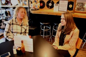 Pictured right, 25-year-old Emily Barnes and 32-year-old Megan Myers, the co-owners of The Human Village Brewing Co. sitting inside the Bus Stop Music Cafe on South Broadway, in Pitman, on Tuesday, Jan. 19, 2016, discussing the brewery industry and their plans to open their brewery in the Bus Stop Music Cafe in the spring. (Spencer Kent | For NJ.com)